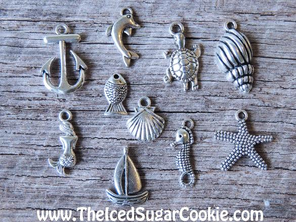 Sea Shells Beach Charms Nautical Anchor Dolphin Turtle Mermaid Boat Fish Seahorse Starfish Clam DIY Do it yourself necklace charms Summer 2016 Sand Jewelry Bracelets Charm by The Iced Sugar Cookie www.TheIcedSugarCookie.com Jewelry for girls and women. Crafts for jewelry making.