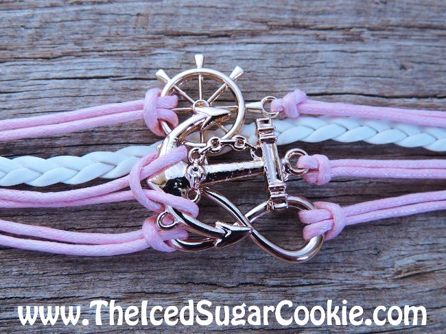 Pink and white leather bracelets with anchor and infinity sign and ship steering wheel by The Iced Sugar Cookie. www.Theicedsugarcookie.com