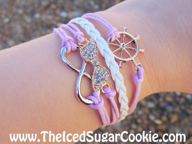 Pink and White Leather Bracelet by The Iced Sugar Cookie www.TheIcedSugarCookie.com - Infinity sign with rhinestone bow and ship steering wheel nautical girls women bracelets